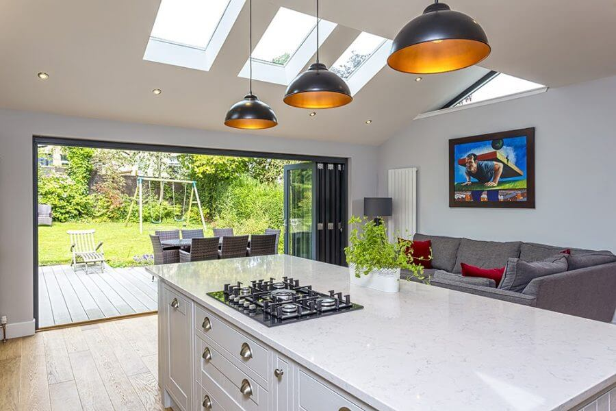 a modern kitchen with garden views